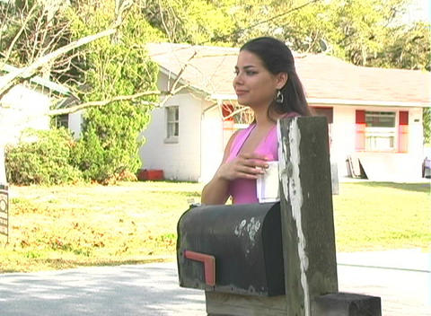 Hot Brunette Gets her Mail-3c Stock Video Footage