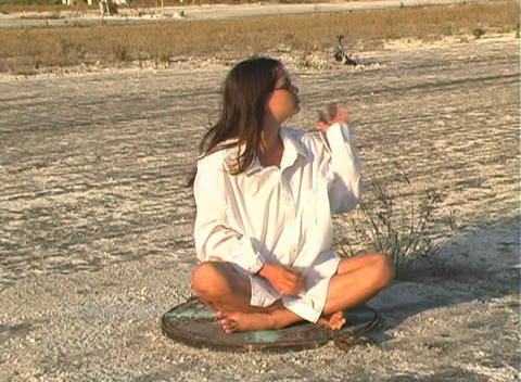 Hot Brunette on a Manhole Cover Footage
