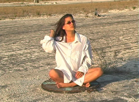 Hot Brunette on a Manhole Cover Stock Video Footage