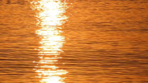 reflection of sunrise over the sea Stock Video Footage