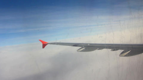 wing aircraft entering into the layer of clouds Stock Video Footage