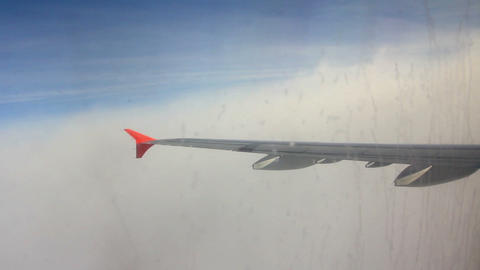 wing aircraft entering into the layer of clouds Footage
