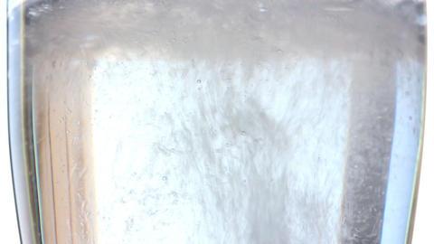 dissolution of effervescent aspirin tablet - slow Stock Video Footage