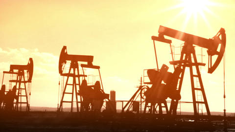 working oil pumps silhouette - old movie styled Stock Video Footage
