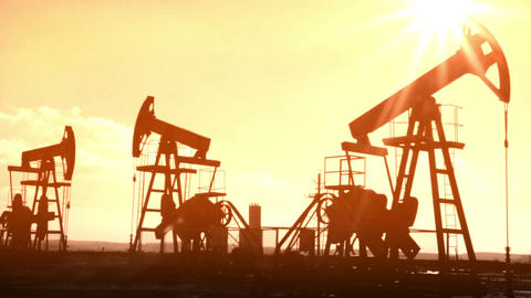 working oil pumps silhouette - old movie styled Footage