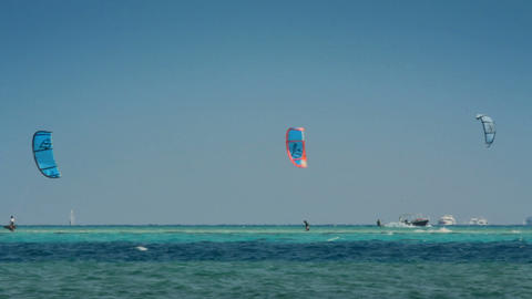 kite surfing - surfers on blue sea surface Stock Video Footage