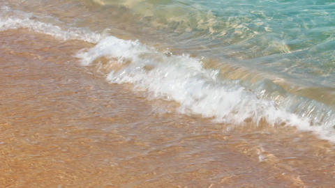 turquoise sea water waves and sand beach Footage