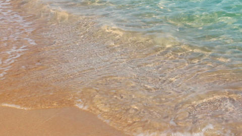 turquoise sea water waves and sand beach - timelap Stock Video Footage