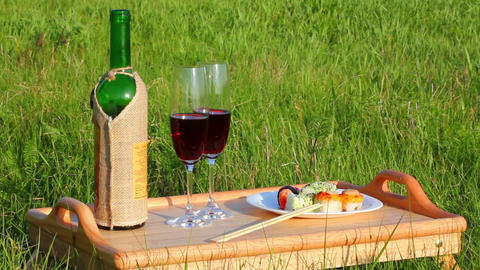 picnic - tabe with wine and japanese food Footage