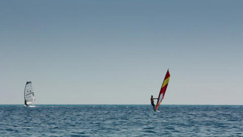 windsurfing - surfers on blue sea surface Stock Video Footage