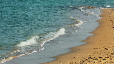 turquoise sea water waves and sand beach - slow mo Stock Video Footage