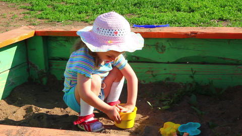 little girl playing in sandbox Footage