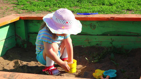little girl playing in sandbox Stock Video Footage