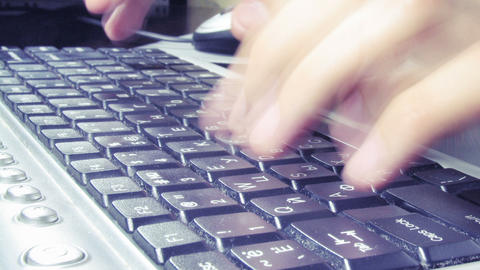 close-up of hands typing on keyboard timelapse Stock Video Footage