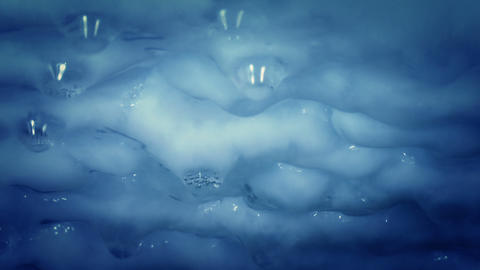 thawing blue icicles with water droplets Stock Video Footage