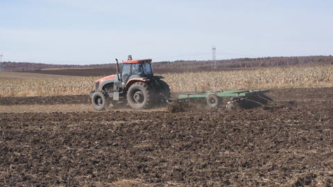 Tractor plowing the autumn field 02 Footage