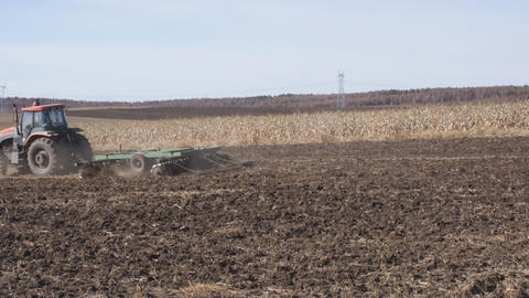 Tractor plowing the autumn field 02 Stock Video Footage