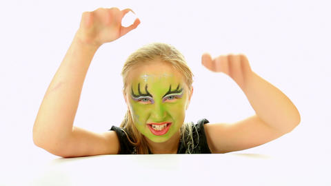 Scary little green girl for Halloween on white Footage