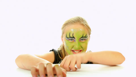 Scary little green girl for Halloween on white Stock Video Footage