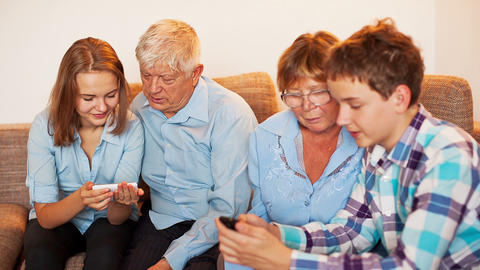 Teenagers and Old Persons Learn Smartphone Stock Video Footage