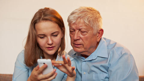 Young Girl and Old Person Learn Smartphone Stock Video Footage