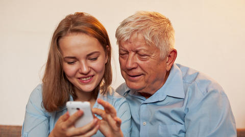 Young Girl and Old Person Learn Smartphone Footage