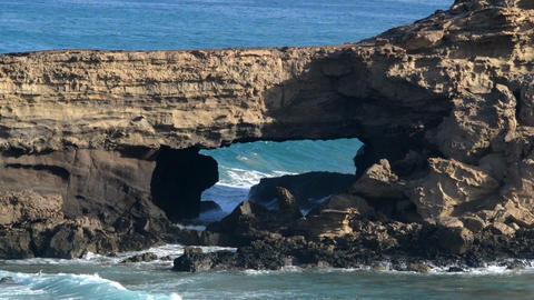 wave chrash into lava cave 11092 Stock Video Footage