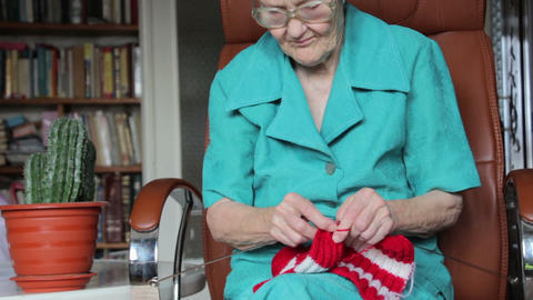 Old Woman Knitting stock footage