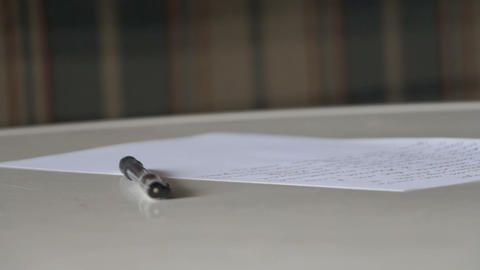 pen, letter, glasses and envelopeon on table Stock Video Footage