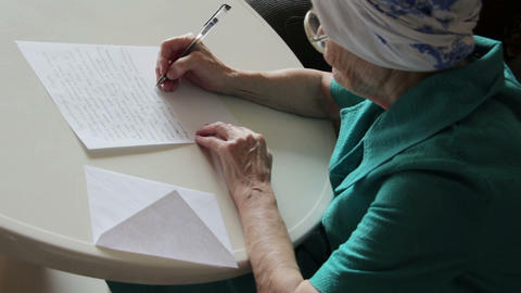 old woman writing letter Stock Video Footage