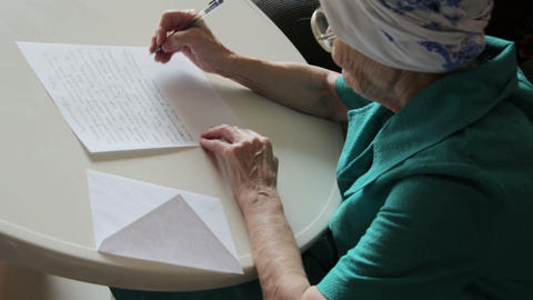 old woman writing letter Footage