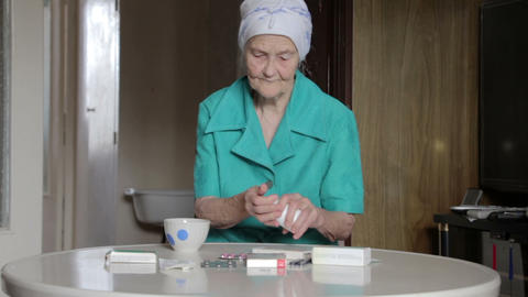 old woman taking pill Stock Video Footage