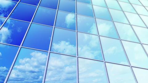 clouds reflected in windows of skyscraper loop Stock Video Footage