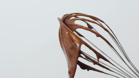 Wire whisk in chocolate Stock Video Footage