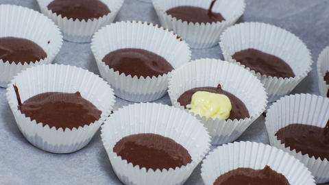 Preparing chocolate cupcakes Stock Video Footage