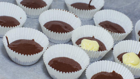 Preparing chocolate cupcakes Stock Video Footage