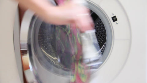 put the clothes in the washing machine Stock Video Footage