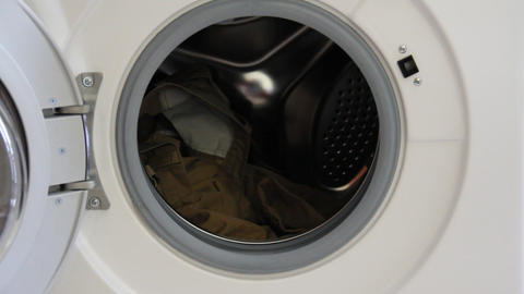 put the clothes in the washing machine Footage