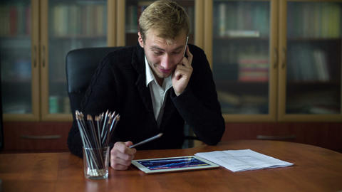 Businessman On The Phone While Working 1 Footage