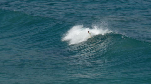 surfer riding a wave 11097 Stock Video Footage