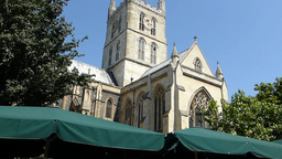 Navigating through crowded Borough Market near Southwark Cathedral, London, UK Footage