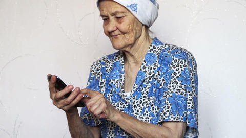 old woman using smartphone Stock Video Footage
