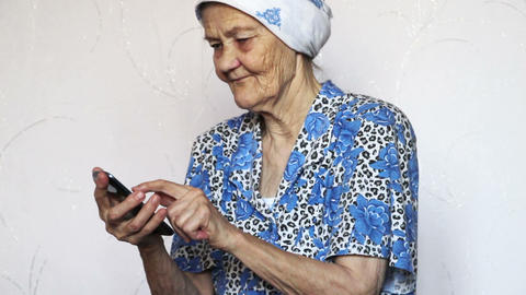 old woman using smartphone Footage