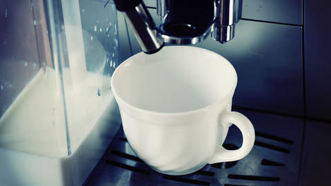 coffee machine pouring cappuccino in cup Stock Video Footage