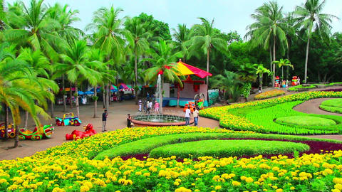 Peoples Walks In Nong Nooch Tropical Garden In Tha stock footage