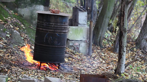 cooking in a barrel Stock Video Footage