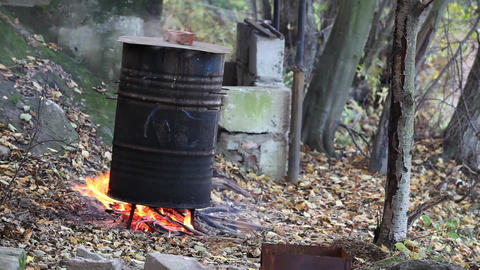 Cooking In A Barrel stock footage