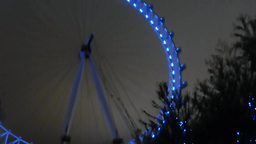 London Eye lighted up in blue color lightings, UK, London Footage