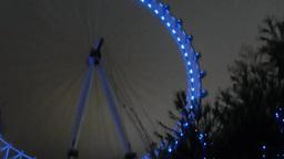 London Eye lighted up in blue color lightings, UK, London Footage