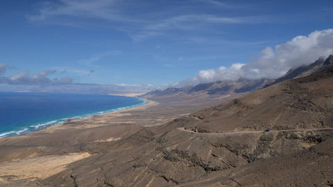 fuerteventura time lapse cloud and waves pan 11110 Stock Video Footage